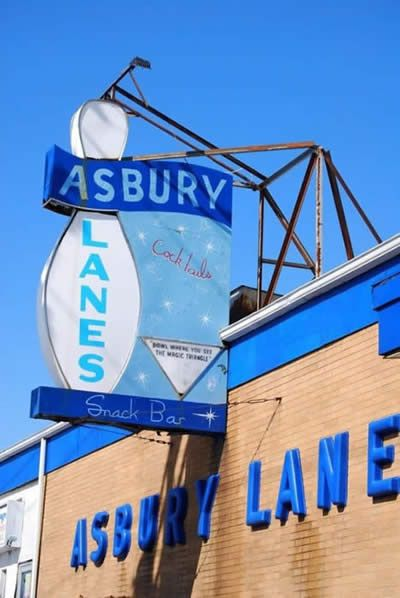 Asbury Park, NJ - Asbury Lanes boasts retro '50s décor, a lounge with an art gallery and a stage smack in the middle of its 20 bowling lanes. Live performances range from punk to blues; the venue also hosts flea markets, art shows, record fairs and vintage car shows. The snack bar features an extensive veggie-friendly selection, and the drinks are strong. Just be prepared to tally up your own bowling scores—you won't find any electronic monitors here.