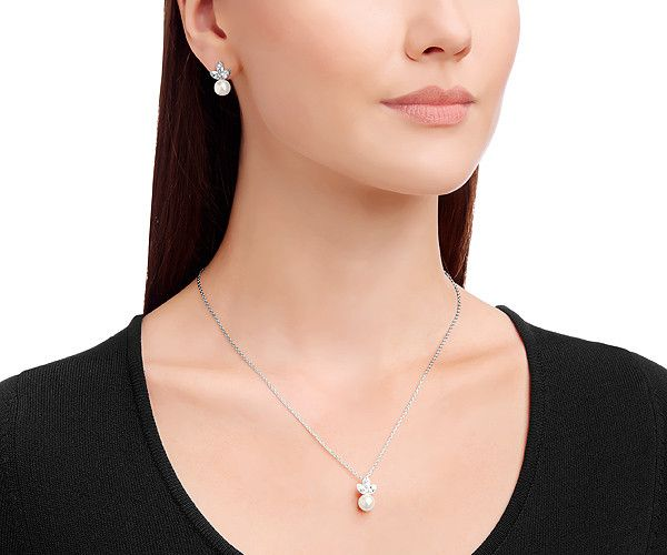 The sophisticated, contemporary design of The Classy Set offers a unique mix of Swarovski Crystal Pearl and sparkling clear crystal. You will be understated elegance at any event in this set.