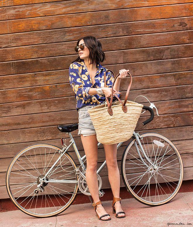 Sunglasses, bike, straw bag, flower printed shirt, denim shorts, sandal heels / Garance Doré