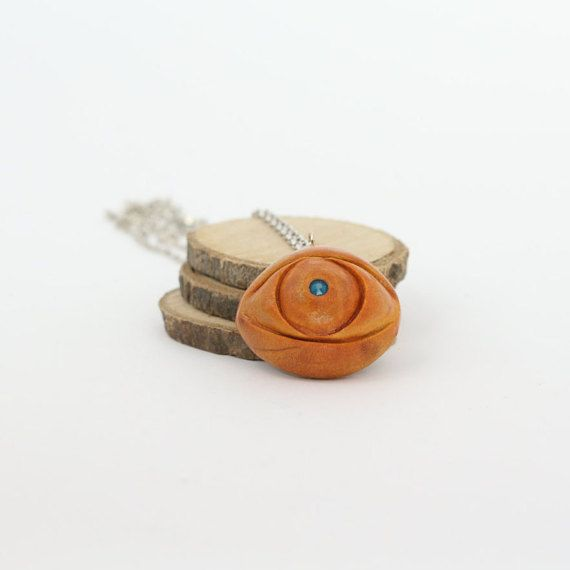Hey, I found this really awesome Etsy listing at https://www.etsy.com/listing/468845894/eye-charm-necklace-avocado-seed-pendant