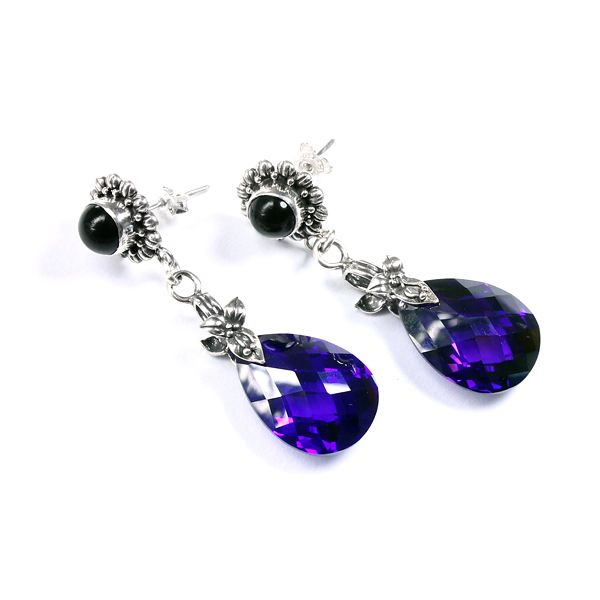 Silver and purple cubic zirconia earrings.