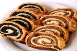 Hungarian Walnut and Poppy Seed Rolls (bejgli)  Walnut filling has also raisins lemon apple honey  Poppy seed filling has also raisins and apricot jam  Both have vanilla sugar, no eggs