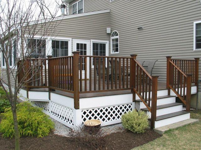 Custom sunroom addition with mahogany deck