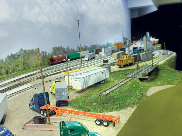 Looking north at the recently-scenicked turntable pit, lead track, and ramp entrance. I still need to add static grass and trees throughout this area and weather the ramp.  Photo post-processing by Scott Thornton. Joe Atkinson's HO Iowa Interstate