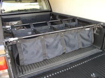 Avoid bulky truck boxes and extenders and stay away from flimsy cargo nets. Description from pickupspecialties.com. I searched for this on bing.com/images