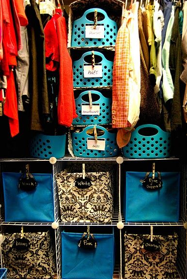 "Closet organization;   Don't really like the color-coated bins or the baskets down the middle, but could totally implement this to work differently.   Could use the bottom bins for other things, such as ""Shorts, Jean Shorts, Pants, Jeans, Skirts, Pajama Pants"".   As for the middle baskets, use those for things like scarves, belts, socks, etc."