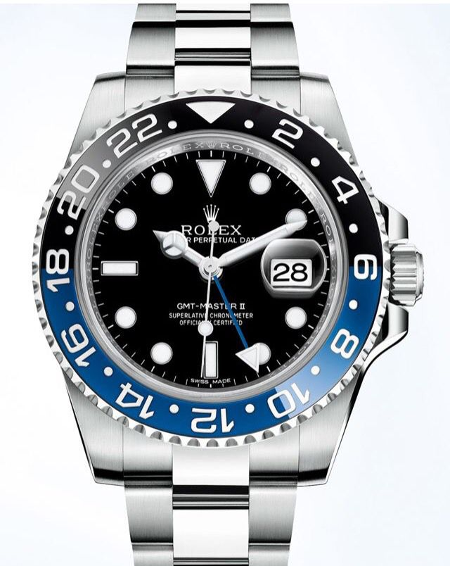 """Rolex GMT """"Bruiser""""  Cerachrom Bezel with numbers that are coated  with a thin layer of platinum, then diamond polished.  Cerachrom is Rolex's patented proprietary process to make their own ceramic; once thought impossible to make a two-tone color ceramic bezel."""