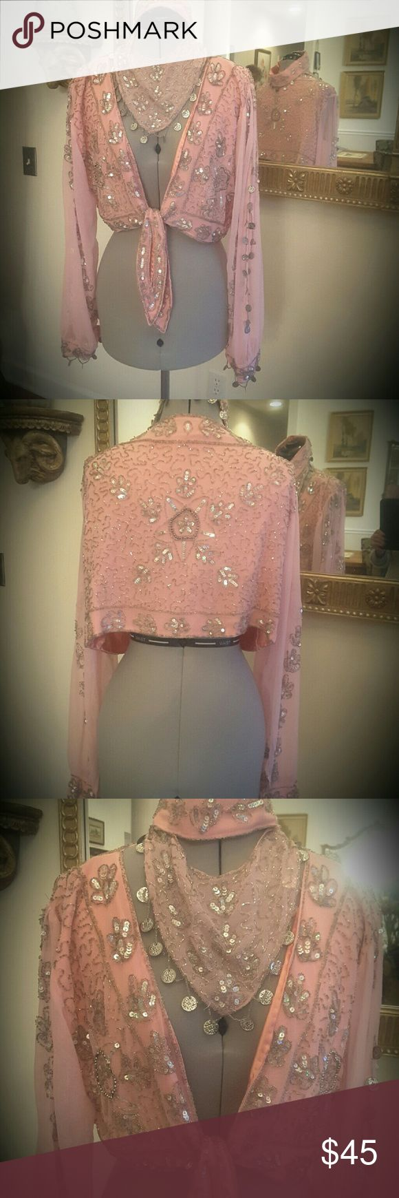 Moroccan top on face piece Really fun Moroccan dance top/headpiece, pink, lots of sequins, beading and round charms for sound, hand-made,  easily adjustable as it ties in the front Unknown  Tops