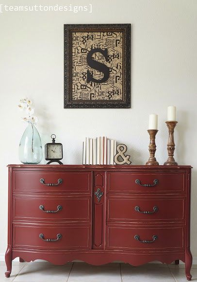 "Team Sutton Designs​ painted this eye catching dresser in a custom milk paint color called ""Sangria Red"". They mixed 2 parts Holiday Red with 1.5 parts Lamp Black and the result is this amazing hue. It was also sealed with GF's High Performance Top Coat in satin."