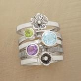 Stack ring. Has my husband's, daughter's, and son's birthstones! ♥