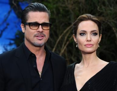 A Secret Wedding for Brad and Angelina in August 2014: Brad Pitt and Angelina Jolie attend a private reception as costumes and props from Disney's 'Maleficent' are exhibited in support of Great Ormond Street Hospital at Kensington Palace on May 8, 2014 in London, England.