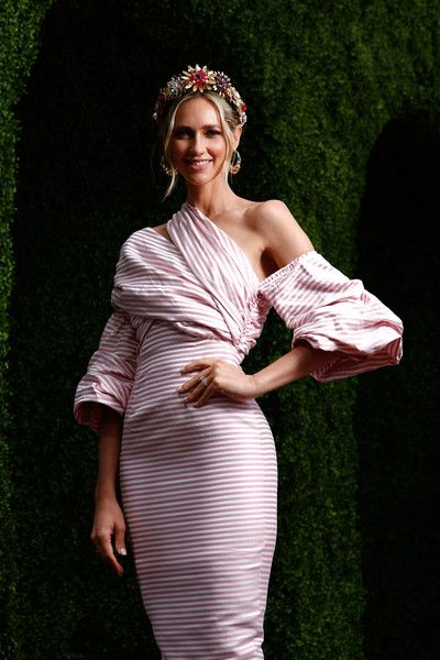 Nikki Phillips Photos Photos - Nikki Phillips poses on Emirates Melbourne Cup Day at Flemington Racecourse on November 1, 2016 in Melbourne, Australia. - Around Emirates Melbourne Cup Day