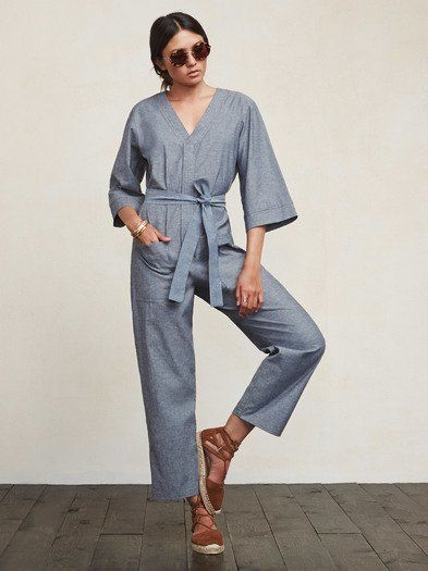Jumpsuits are great because they're a shirt and pants in one package. Just throw it on and you've got yourself an outfit. Done. The Jiro Jumpsuit is a medium weight woven jumpsuit with a snap V neckline, zip front and pockets. The sleeves and legs are a bit cropped. The fit is loose and comfortable but we included a self belt in case you'd like more of a waist. Chic and easy, and it only took one step.  Made from surplus cotton blend.