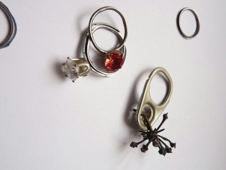 Rings made of cans and broken pieces of jewelery by Ivča Vostrovska.
