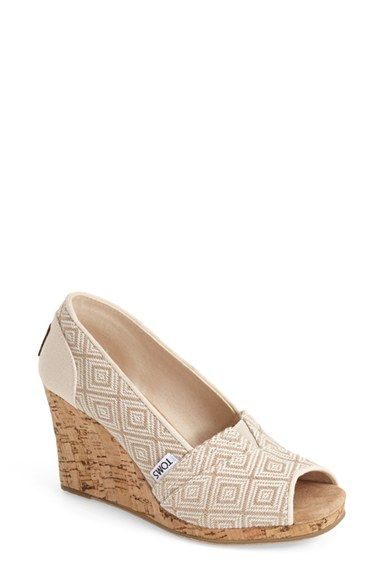 Free shipping and returns on TOMS 'Classic' Woven Wedge Sandal (Women) at Nordstrom.com. Taking inspiration from Nepalese textiles, this peep-toe sandal is woven with a tonal diamond pattern for a bit of international flair. A cork wedge furthers the natural, earthy look, while a suede insole and an elastic gore at the vamp lend easy comfort.<br><br>Since Blake Mycoskie started TOMS in 2006, the company has given away 10 million shoes to children in need across the globe through sales of…