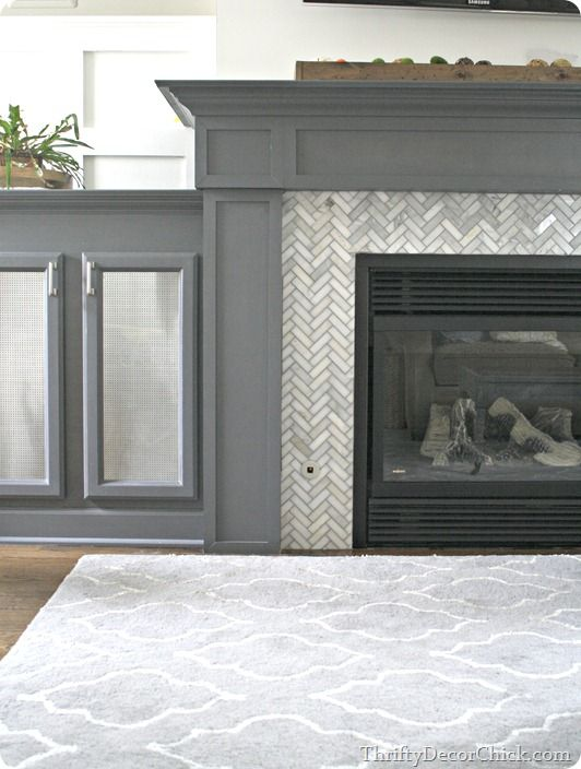From Thrifty Decor Chick, a gorgeous fireplace surround in marble herringbone tile with gray grout--plus her step-by-step guide to getting it done.