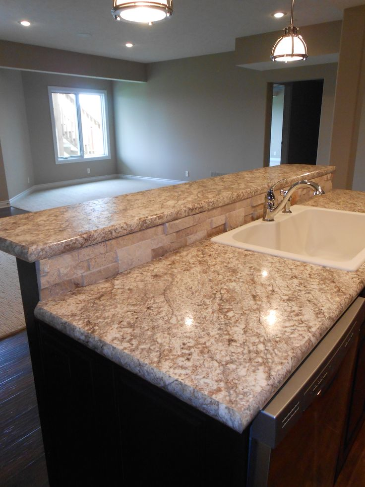 Vencil Homes   Wilsonart HD #laminate on the bar tops  Natural stone ledger panel backsplash