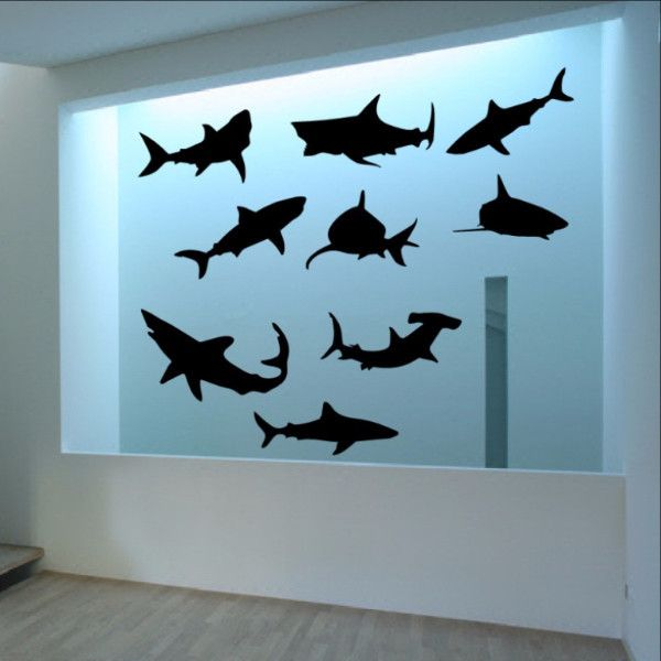 "Wall Decal Set of Nine Sharks Vinyl Wall Decals 22304 This listing includes the 9 sharks shown in photos. Each shark measures approx. 12"" - 15.5"" in length. The sharks come in a sheet for you to cut a"
