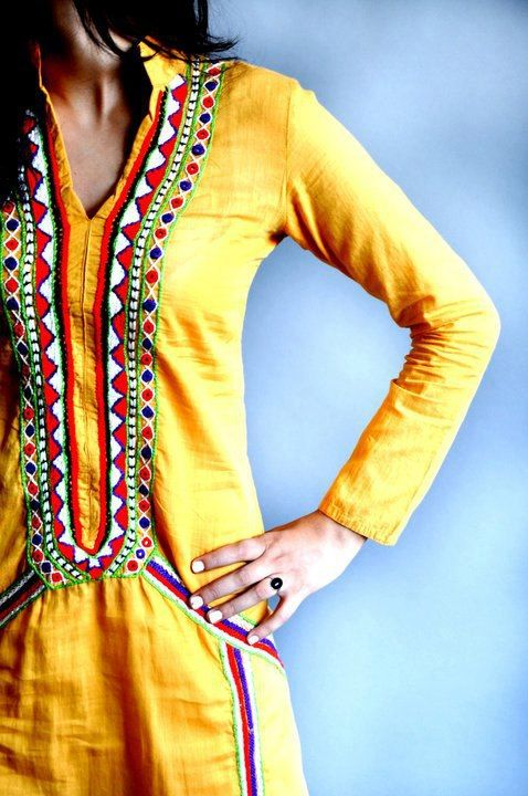 yellow with sindhi embriodery on it