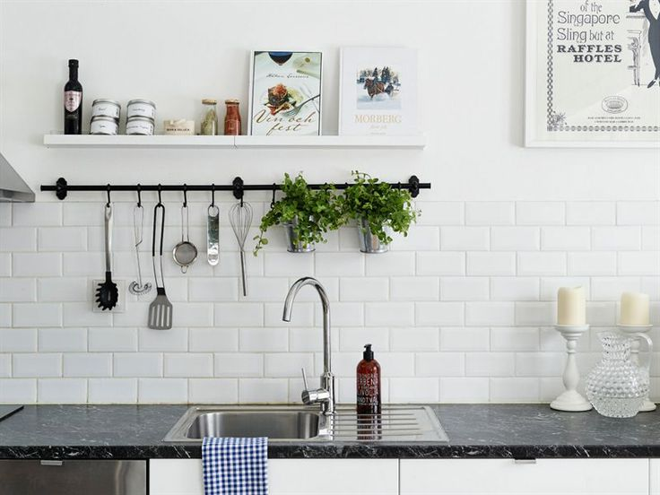 white cabinets, dark marble top and subway tiles