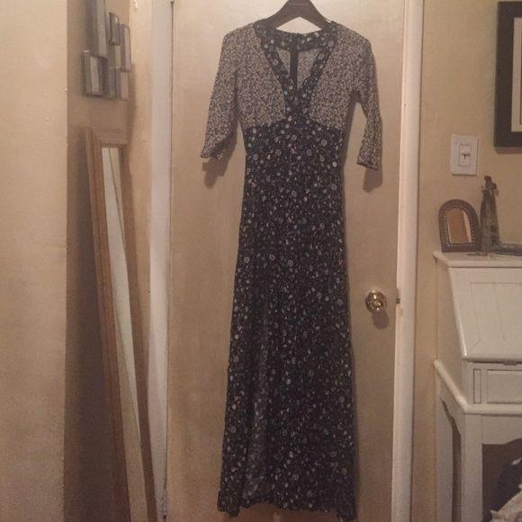 ☀️SALE!!! Millie Mackintosh NWT maxi dress Millie Mackintosh floral maxi dress. Size 8. NWT. Has two high slits up the front, deep v-neck, 3/4 sleeves. Very bohemian. Classy but still sexy. Millie Mackintosh Dresses Maxi