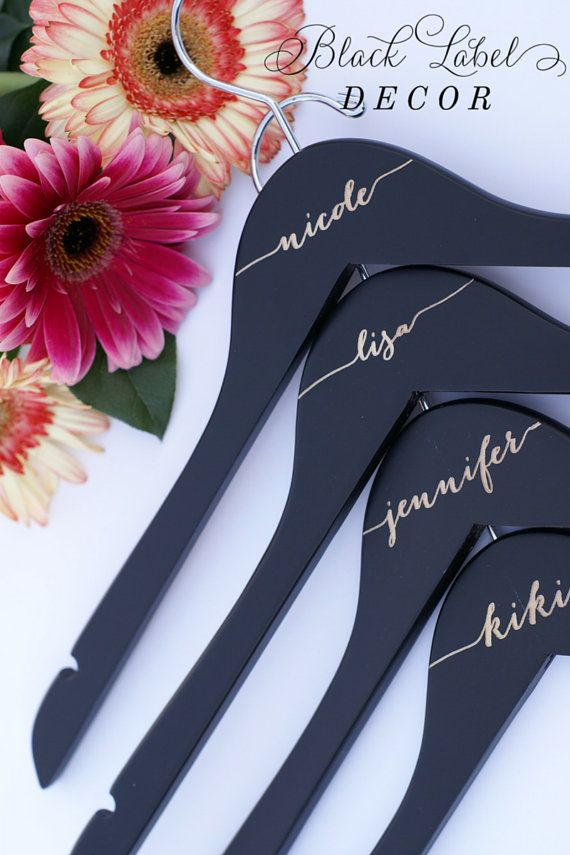 Engraved matte black bridal party wood by BlackLabelDecor  www.blacklabeldecor.com  Home of the original premium matte black engraved bridal hangers!