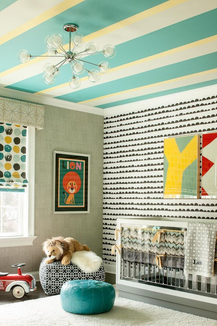 This colorful nursery from Karen Wolf uses strong pattern in the walls and ceiling. It reflects the client's love of pattern and color.