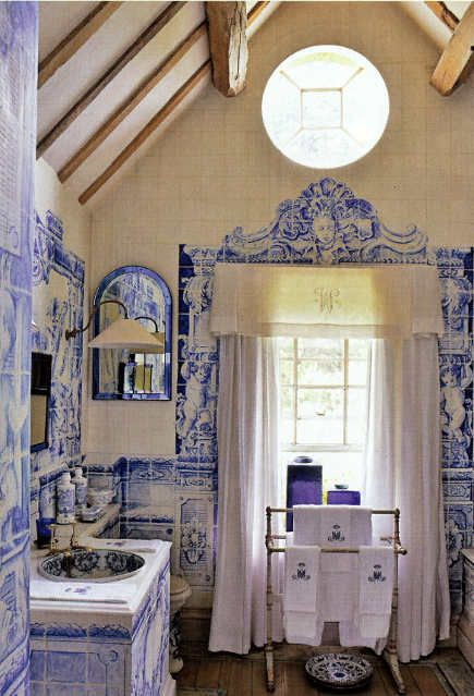 Anouska Hempels bathroom with blue and white Delft tile murals and detailing