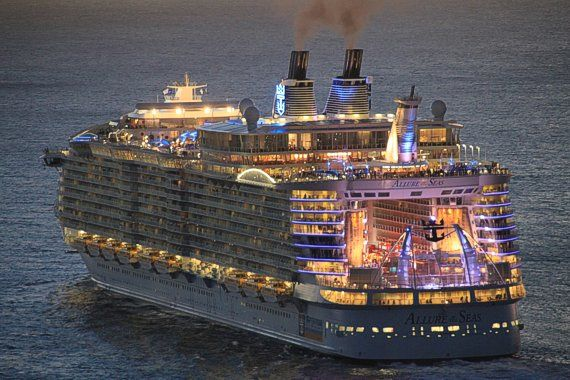 Royal Caribbean Allure of the Seas illuminated as it heads out of port at night! http://www.cruisekings.co.uk/cruise-lines/royal-caribbean-international/