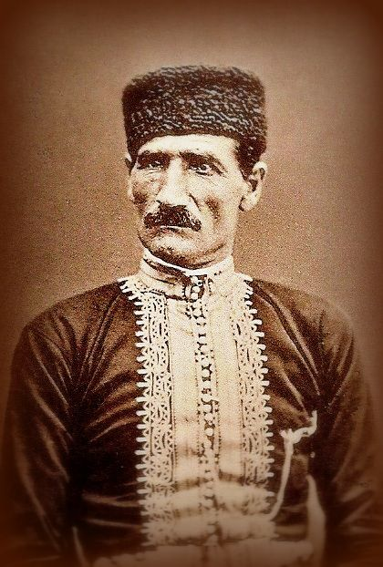 Crimean Tatar in festive/ceremonial outfit. Crimea, ca. 1900.