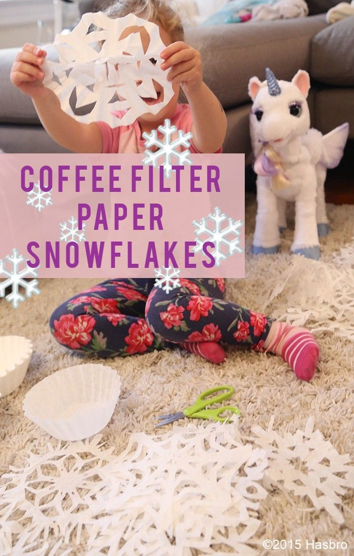 Add a little whimsy to your holiday decor with these coffee filter snowflakes! They are fun for kids and parents to make together! Inspired and sponsored by FurReal Friends StarLily My Magical Unicorn