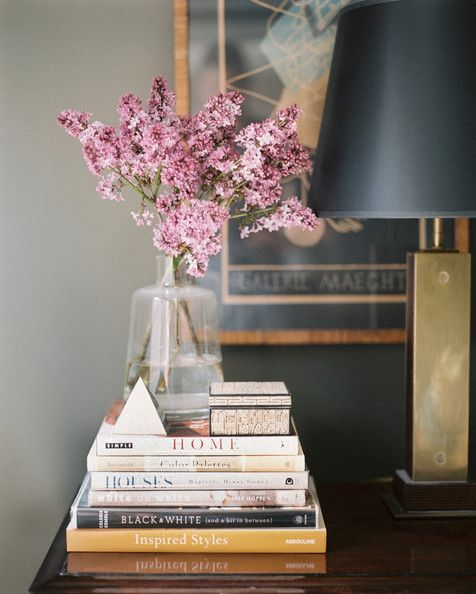 Creative displays of arranging your favorite book....A crisp tower of books looks amazing with flowers placed on top...