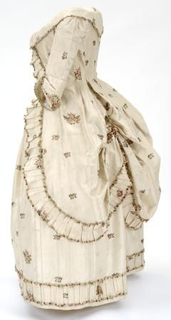 Robe à la Polonaise (side view), English, ca.1780 silk, cream brocaded silk woven with clusters of flowers in pinks and greens.worn by Mary Mcdowell, daughter of William Mcdowall of Castle Semple.The large size of the closed bodice suggests that it may have been worn while Mary was pregnant. This is supported by the diaries of Mrs Jean Houston, Mary's mother-in-law. © CSG CIC