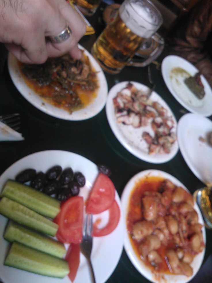 Mezedes at a cafe (as they call it in Crete). Enjoy tsikoudia and draft beer with small plates of tasty snacks