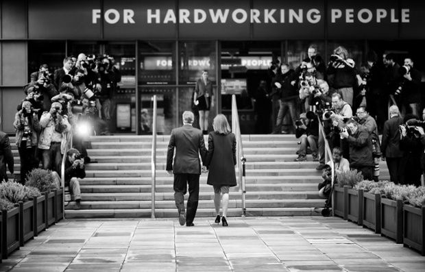 Photographer Christopher Furlong has taken an alternative view of the prime minister, David Cameron, and his wife, Samantha, arriving at Manchester Central