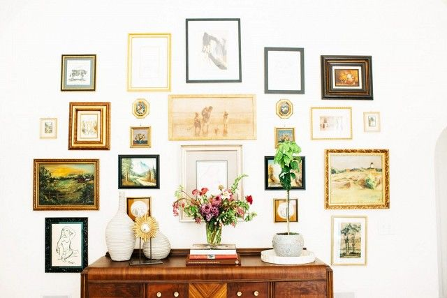 This English tudor with a gallery wall with modern illustrations in varying frames