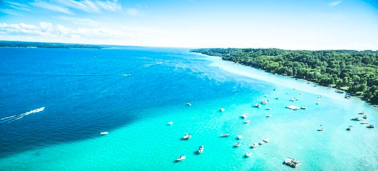 Want an island vacation, but working with a lake budget? Head to Michigan! Yes, Michigan, where you'll find a huge lake with alluring turquoise waters that are reminiscent of tropical destinations in the Caribbean.