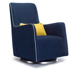 The Grazia Swivel Glider nursing chair in navy with white piping and yellow  lumbar pillow is