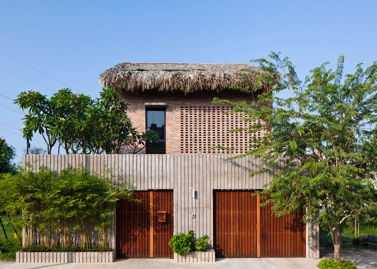 MM++ Architects adds a palm leaf roof to a house in Vietnam