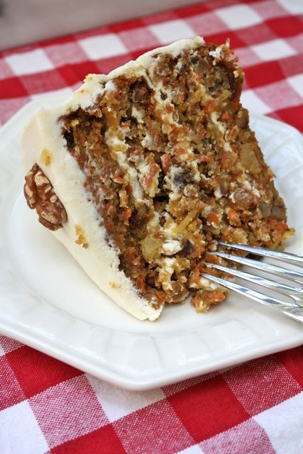 still searching for the perfect carrot cake recipe - maybe this is it minus the walnuts and coconut?  Carrot Cake with Cream Cheese Frosting - Blue-Eyed Bakers - Blue Eyed Bakers