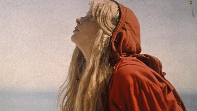 Portrait of Christina wearing a red cloak c.1913.