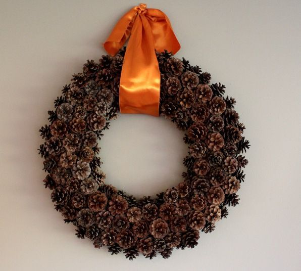 free pinecone wreath, crafts, seasonal holiday d cor, wreaths, Adding a large satin ribbon seems to pull everything together