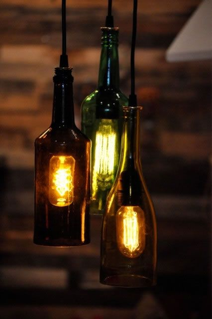 For soft and warm lighting in your dinning try these hanging wine bottle lights.