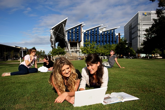 University of the Sunshine Coast students studying on the lawn outside the Library on the USC campus in Sippy Downs. http://www.usc.edu.au/