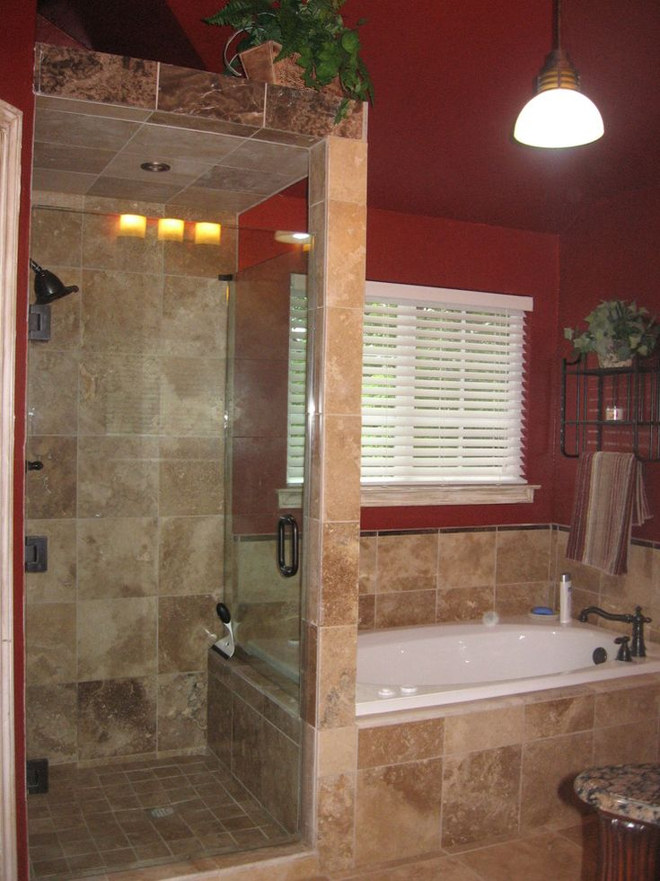 mediterranean bathroom with walk in showers without door with glass door partition to the bathtub area of Walk in Shower without Door for More Air and Light