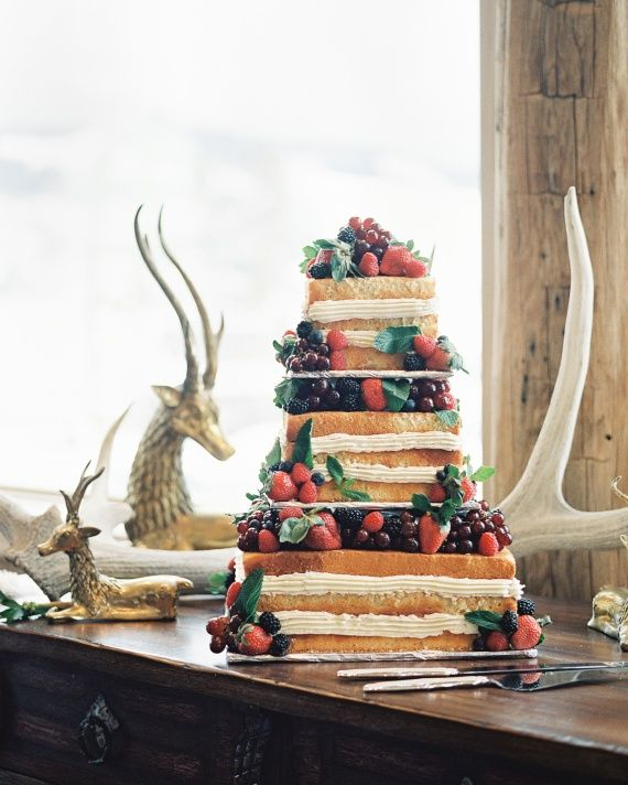 For a twist on a traditional wedding cake, try a version of millefoglie, which was given a festive touch with red fruit and greenery for a winter celebration.
