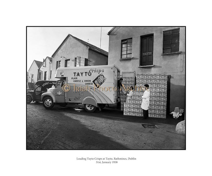 Picture of Loading Tayto Crisps at Tayto, Rathmines.31/01/1958..In 1954 Joe Spud Murphy began what is today's largest snackfood company with just two rented rooms off Moore Street, Dublin. Truly, a remarkable story of one man's determination, his initial set up costs ran to a grand total of £500. The entire staff consisted of Joe, his eight employees and a single van...At the time Tayto crisps sold for 4 pence per bag! They were sold in beautiful tin boxes that contained 18 bags of crisps…