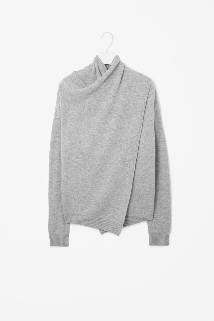 Overlap wool jumper. This looks so cosy - id love to be snuggled up in this with a pair of their greyish coloured boots...