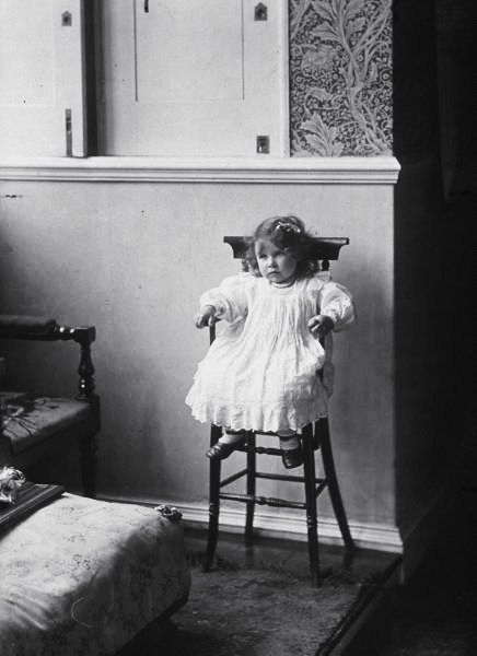 Future Queen Mum, Lady Elizabeth Bowes-Lyon, as a toddler sitting in a high chair. Scotland, August 1902.