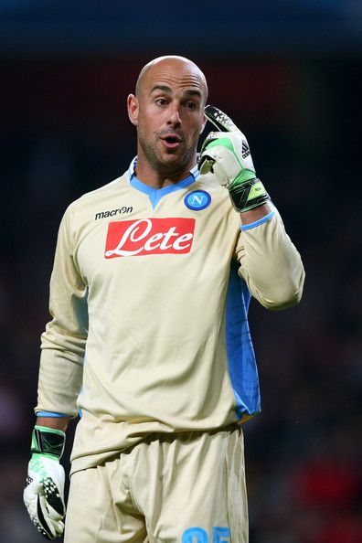 Pepe Reina Photos Photos - Goalkeeper Pepe Reina of Napoli gestures during UEFA Champions League Group F match between Arsenal FC and SSC Napoli at Emirates Stadium on October 1, 2013 in London, England. - Arsenal v SSC Napoli